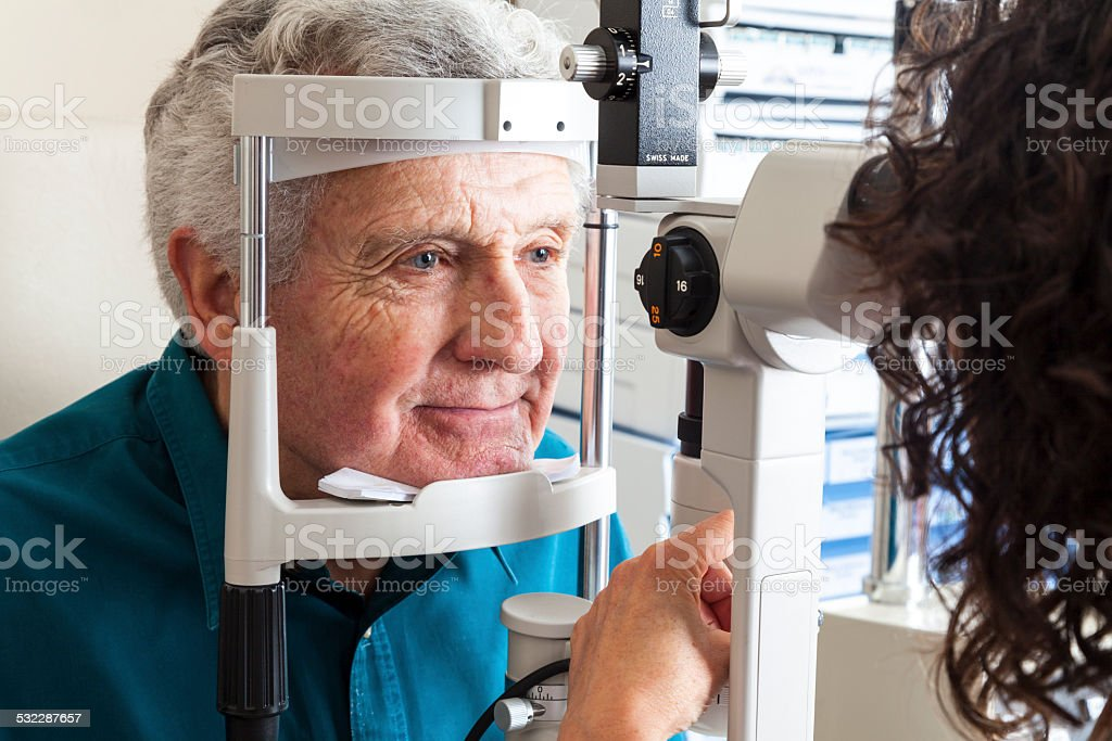 Optometrist with senior patient stock photo