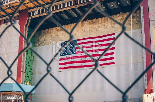 840615050 istock photo USA or American flag trapped behind the fence 1218306208