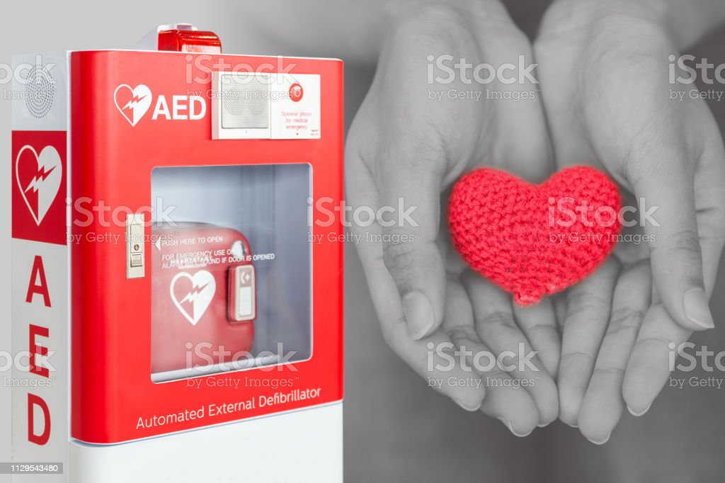 AED or Automated External Defibrillator first aid help giving life heart concept stock photo