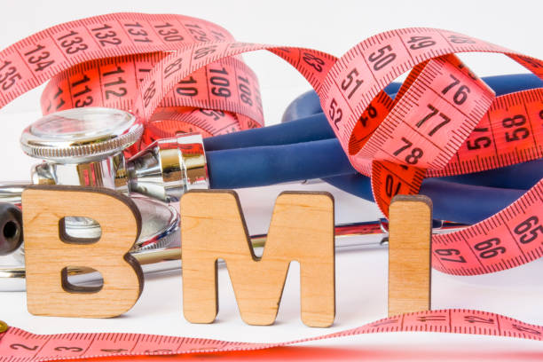 BMI or body mass index abbreviation or acronym photo concept in medical diagnostics or nutrition, diet. Word BMI is on background of tape to measure the circumference of body and medical stethoscope BMI or body mass index abbreviation or acronym photo concept in medical diagnostics or nutrition, diet. Word BMI is on background of tape to measure the circumference of body and medical stethoscope adipose tissue stock pictures, royalty-free photos & images