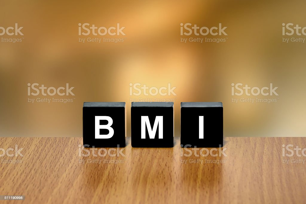 BMI or Body Mass Index on black block stock photo