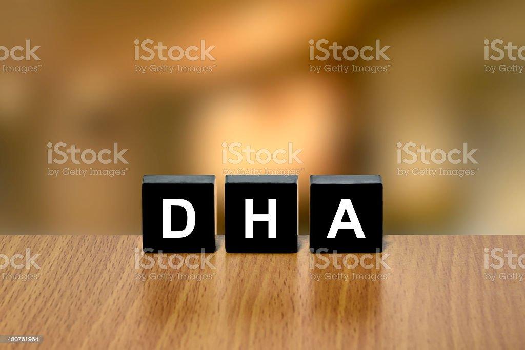 DHA or Docosahexaenoic acid on black block stock photo
