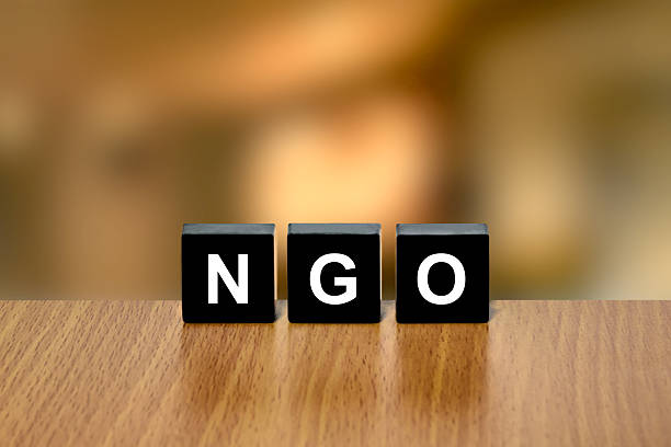 NGO or non-governmental organization on black block stock photo