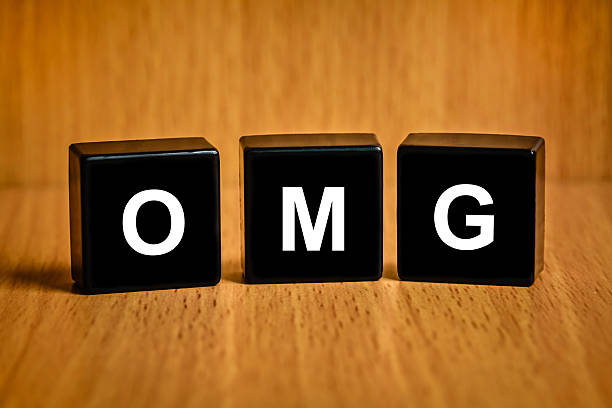 omg or oh my god word on black block - omg stock photos and pictures
