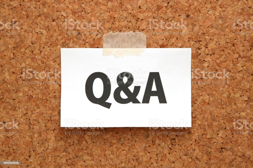 Q&A or Questions and Answers on a piece of white paper on a brown cork board. stock photo