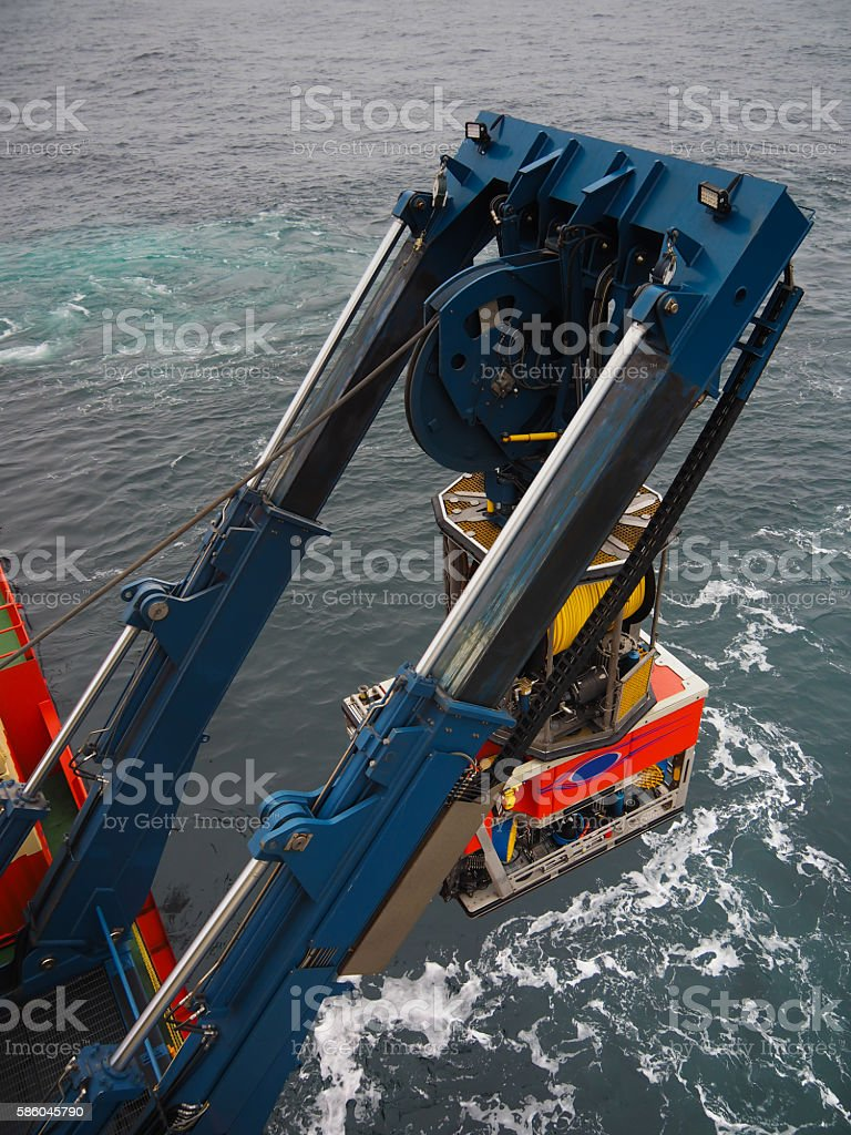 ROV or remote operated vehicle deployed off a ship stock photo