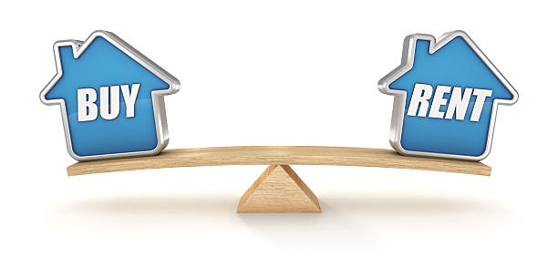 BUY or RENT House icons balance on seesaw isolated stock photo