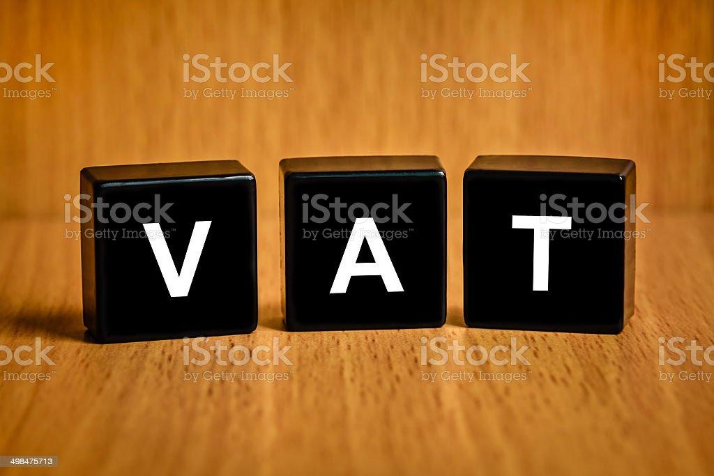 VAT or value added tax word on black block stock photo