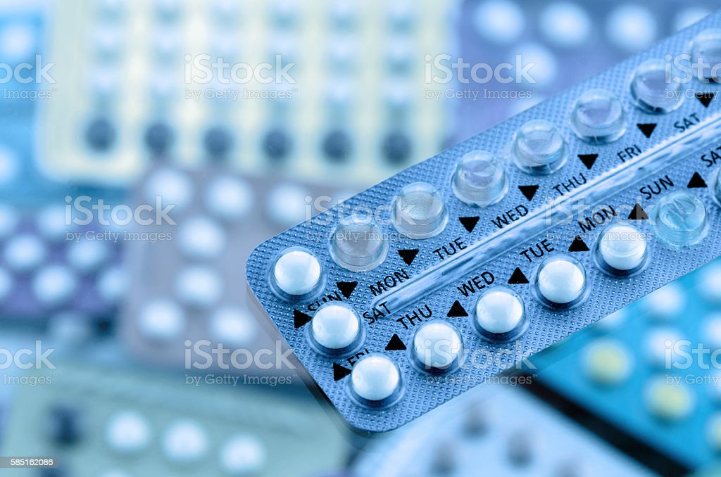 Oral contraceptive pill on pharmacy counter. - foto de stock