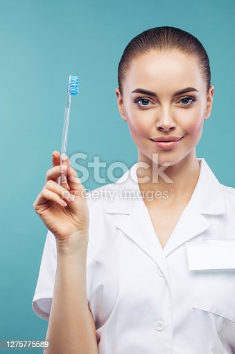 Oral hygiene concept. Doctor with toothbrush