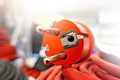 Orange 220 volt plug with kabel close up