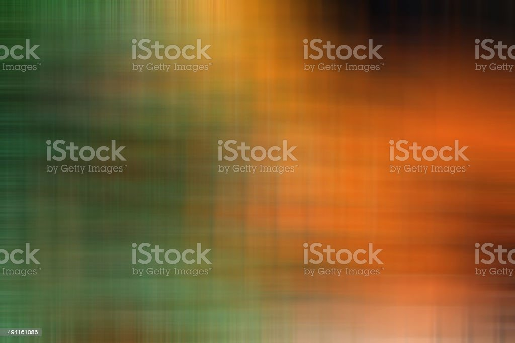 Orange abstract image of green blurred background stock photo