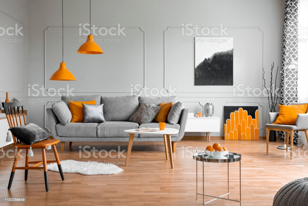 Orange Accents In A Grey Living Room Interior Stock Photo & More ...