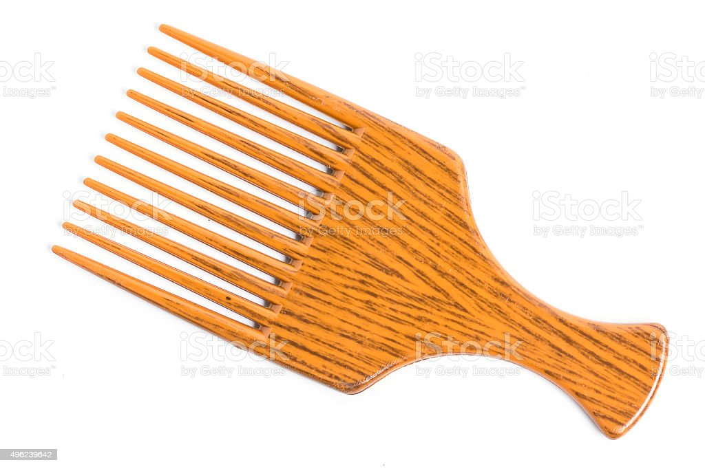 Orange afro pick on white background stock photo