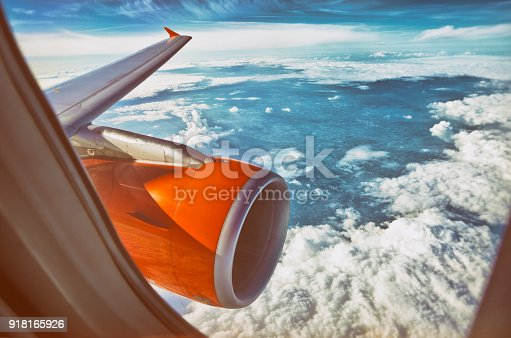 Vintage photography of an orange aircraft jet engine