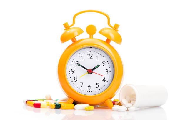 orange alarm clock and medical pills - sleeping pill stock photos and pictures