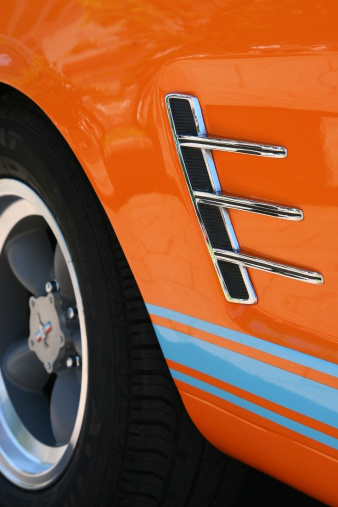 Side view of an orange american classic car