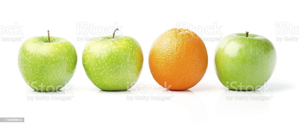 Orange Among Green Apples royalty-free stock photo