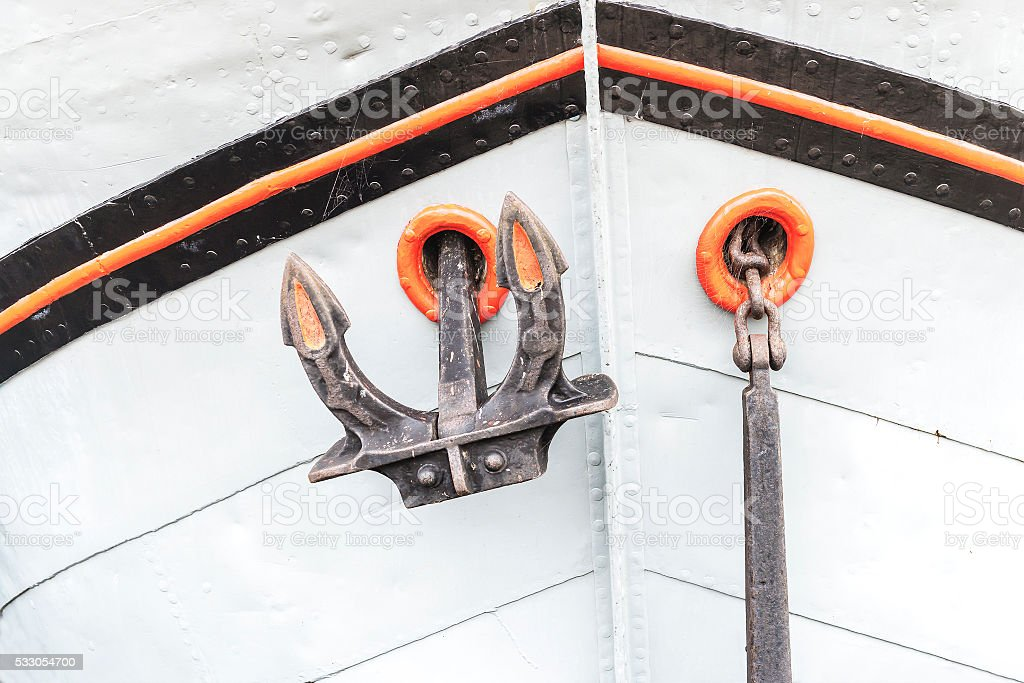 Orange anchor on wooden ship in Amsterdam stock photo