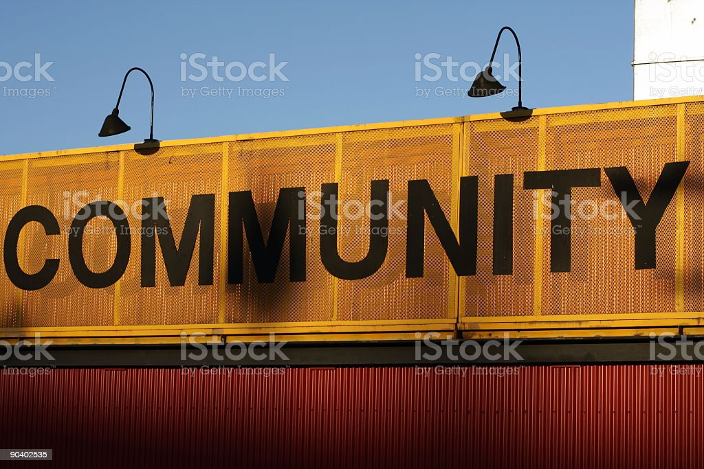 Orange and Black Community Sign on a Building stock photo