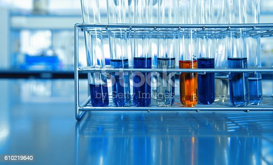 istock orange and blue chemical solution in test tubes in science lab 610219640