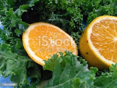 istock orange and curly kale leaves 1282055861