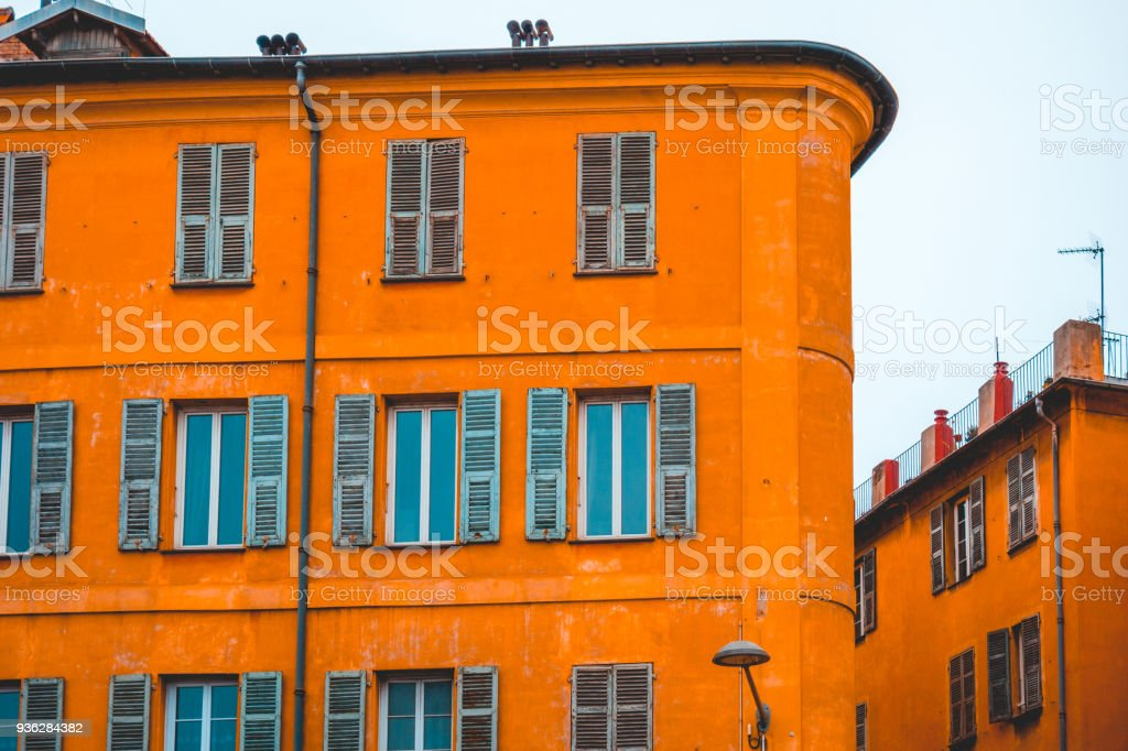 orange and curved apartment complex with mediterranean colors stock photo