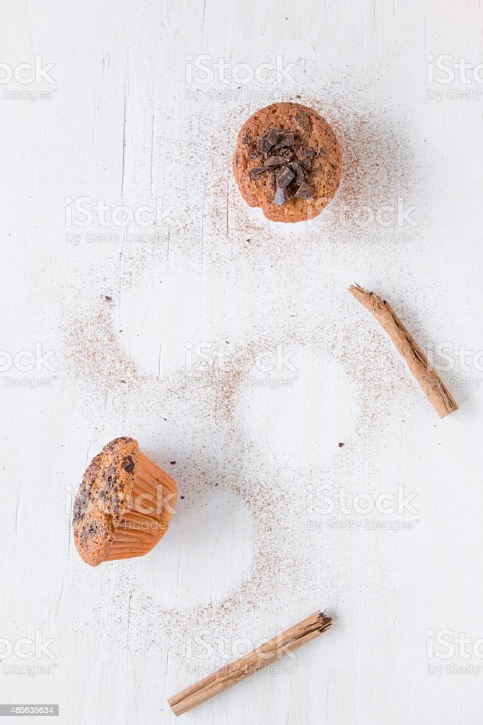 Orange and dark chocolate muffins with two cinnamon sticks. stock photo