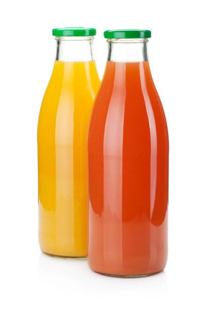 orange and grapefruit juice bottles - fruit juice bottle isolated foto e immagini stock