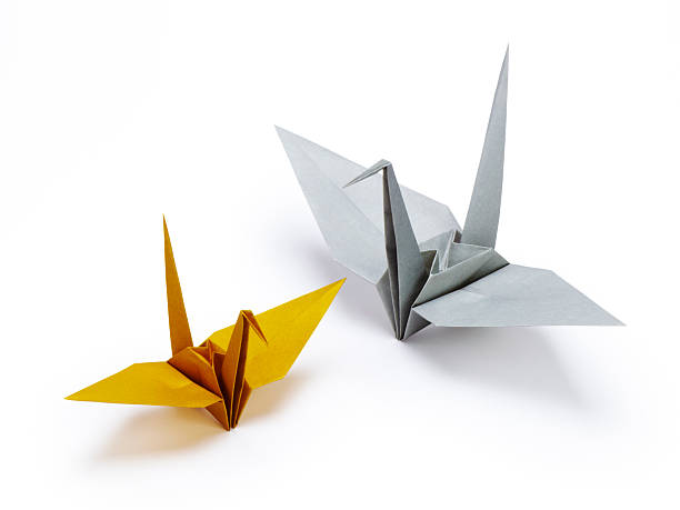 Orange and gray origami cranes stock photo