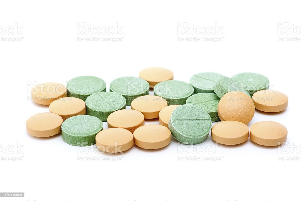 Orange and green tablets royalty-free stock photo