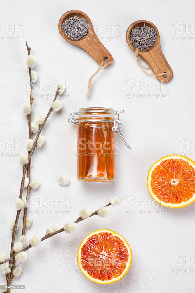 Orange and lavender body care products. Aromatherapy, spa and natural healthcare concept stock photo