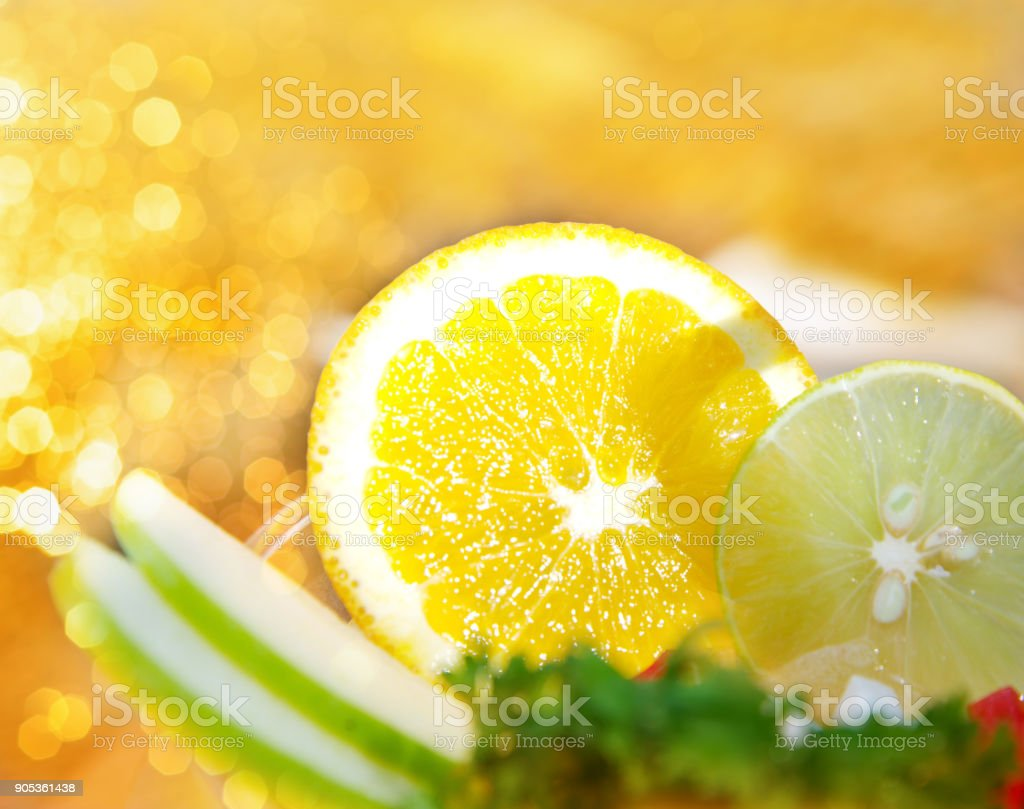 orange and lemon fruit on juice drink with bokeh light background stock photo