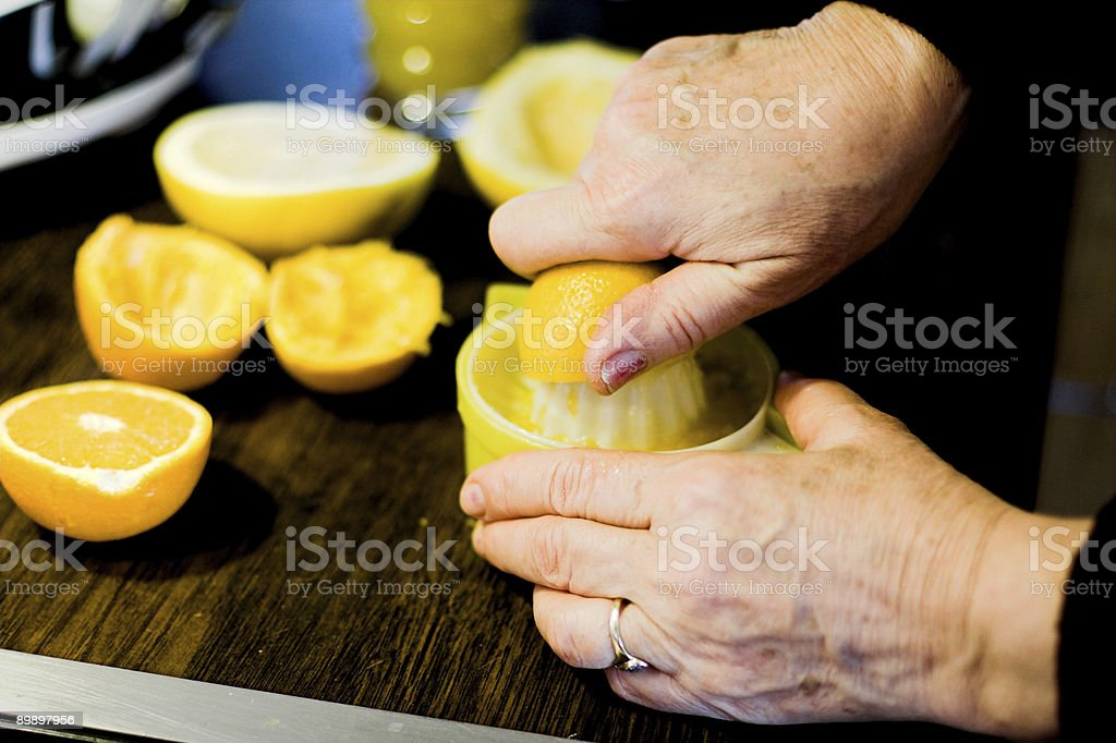 Orange and lemon juice preparing royalty free stockfoto