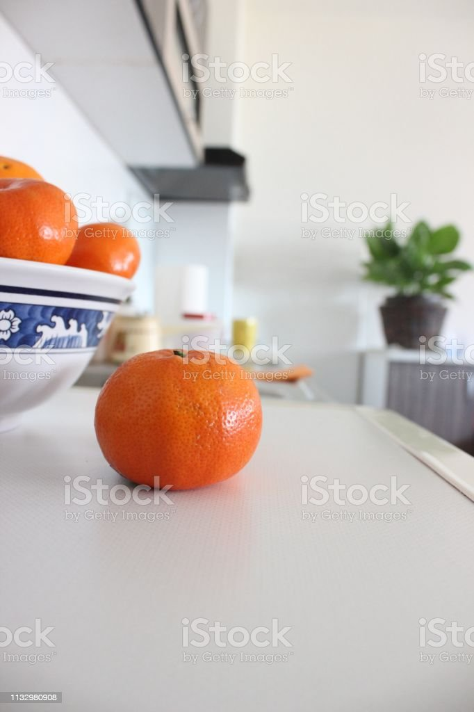 Close up on big orange and apples and mandarin oranges fruits in a...