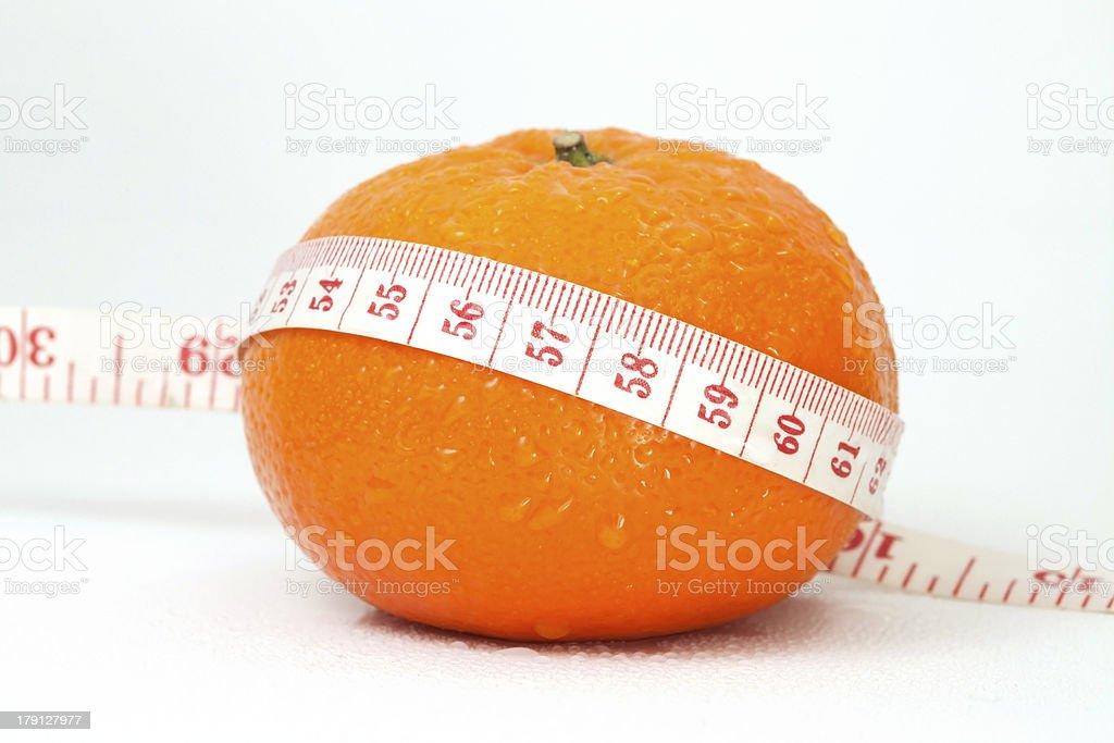 Orange and measuring tape royalty-free stock photo