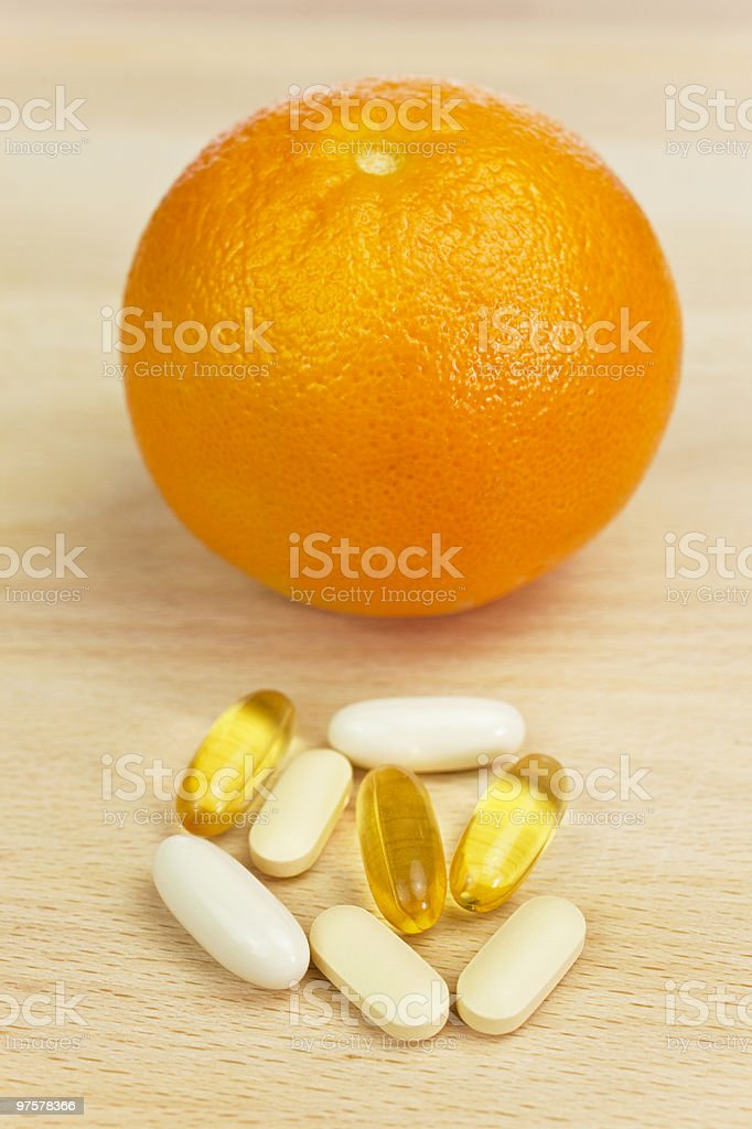 Orange and Nutrition Supplement Tablets or Medicine royalty-free stock photo