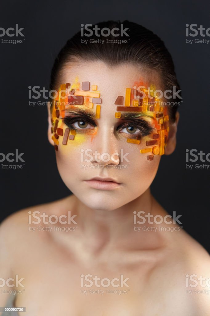 Orange and Red Rhinestones on a Girl Face royalty-free stock photo