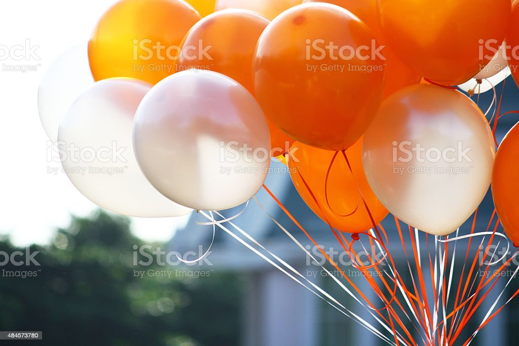 Orange and white balloons stock photo