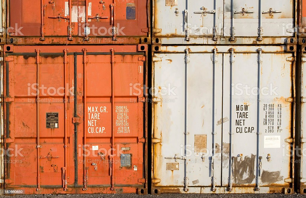 Orange and white containers sitting right next to each other royalty-free stock photo