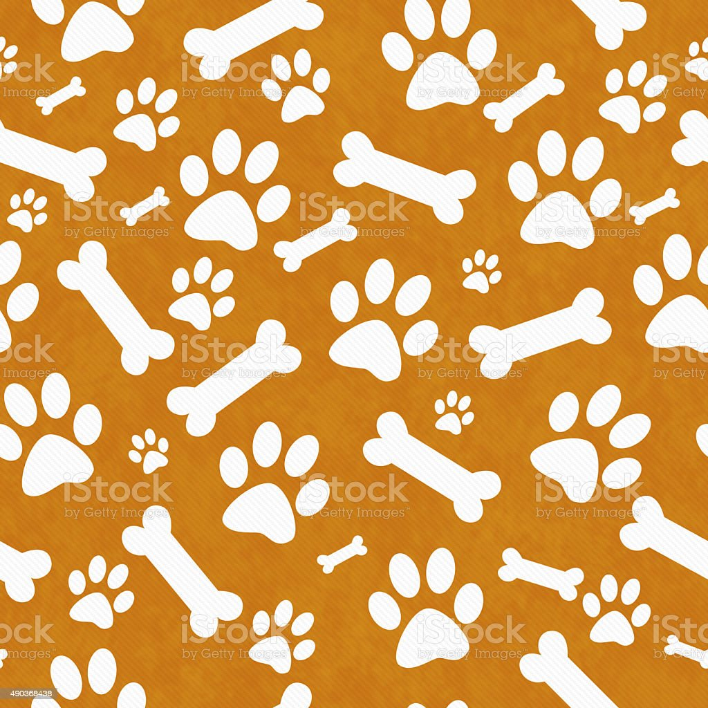 Orange and White Dog Paw Prints and Bones Repeat Background stock photo