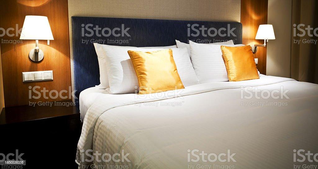 Orange and white luxury hotel room stock photo