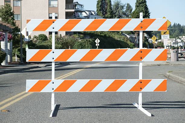 Orange and white road barricade stock photo