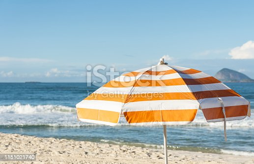 Orange and White Striped Beach Umbrella
