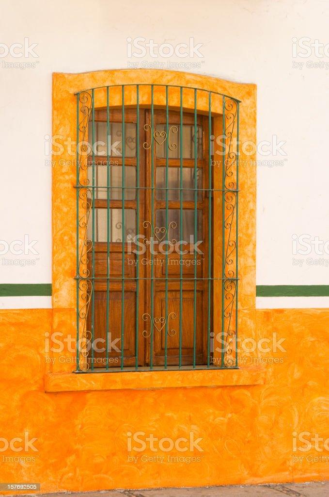 Orange and White Wall With Window royalty-free stock photo