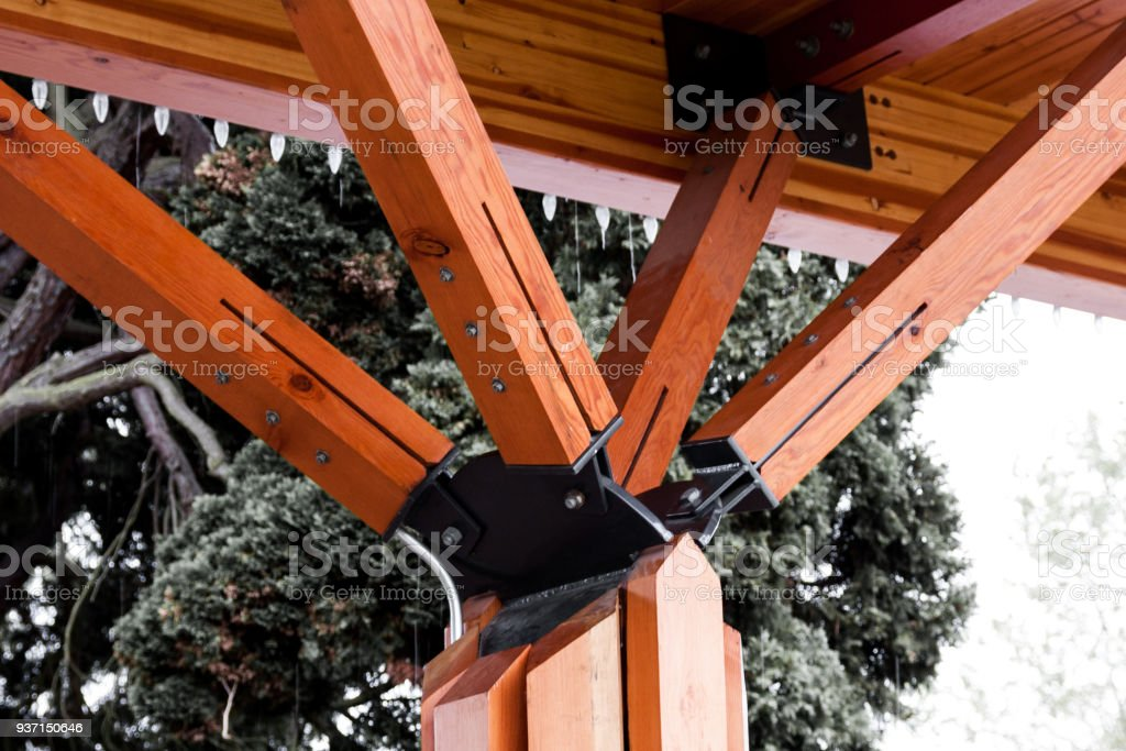 Orange angled outdoor roof support beams coming to a point stock photo