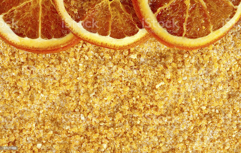 orange aromatic sea salt with some dried slices, background royalty-free stock photo