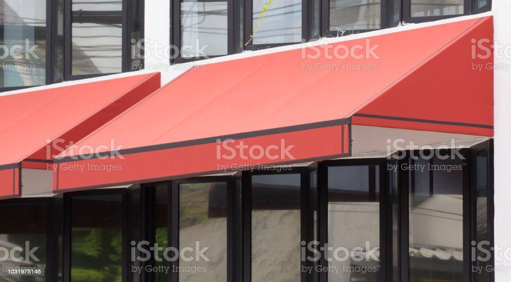 Orange Awning Over Glass Windows And Black Aluminium Frame Canvas Shading Stock Photo Download Image Now Istock