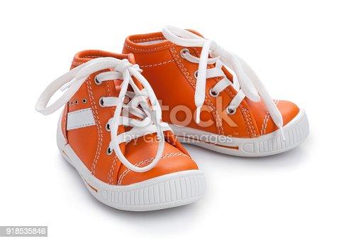 Orange baby shoe's with white shoelace isolated on white background