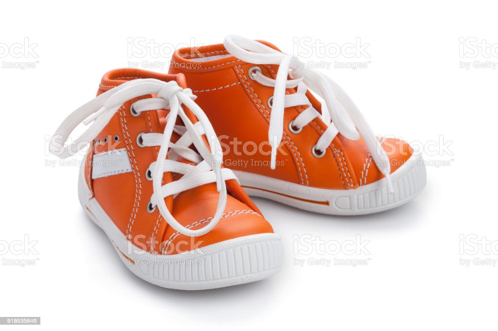 Orange baby shoe's - Isolated stock photo